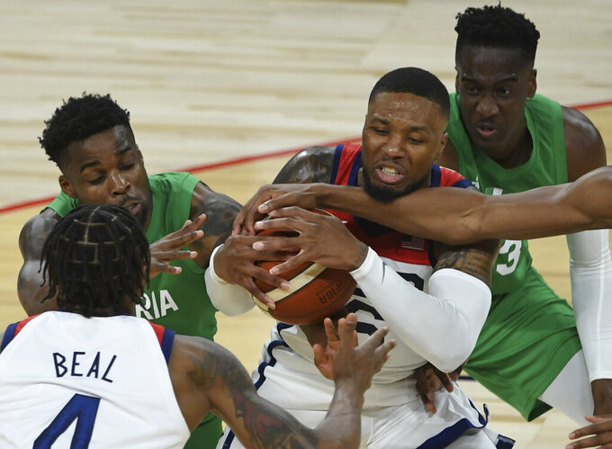 United States' Damian Lillard (6) defends the ball against Nigeria during an exhibition basketball game Saturday, July 10, 2021, in Las Vegas. (AP Photo/David Becker)