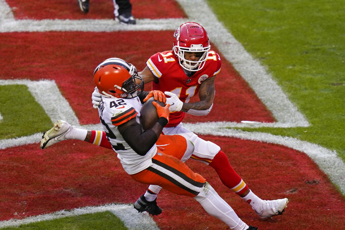 Cleveland Browns safety Karl Joseph (42) intercepts a pass in the end zone in front of Kansas City Chiefs wide receiver Demarcus Robinson (11) during the second half of an NFL divisional round football game, Sunday, Jan. 17, 2021, in Kansas City. (AP Photo/Orlin Wagner)