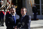 French President Emmanuel Macron, right, and Lebanese Prime Minister Saad Hariri shake hands during a joint press conference in the garden of the Elysee Palace, Friday, Sept. 20, 2019 in Paris. (AP Photo/Francois Mori)