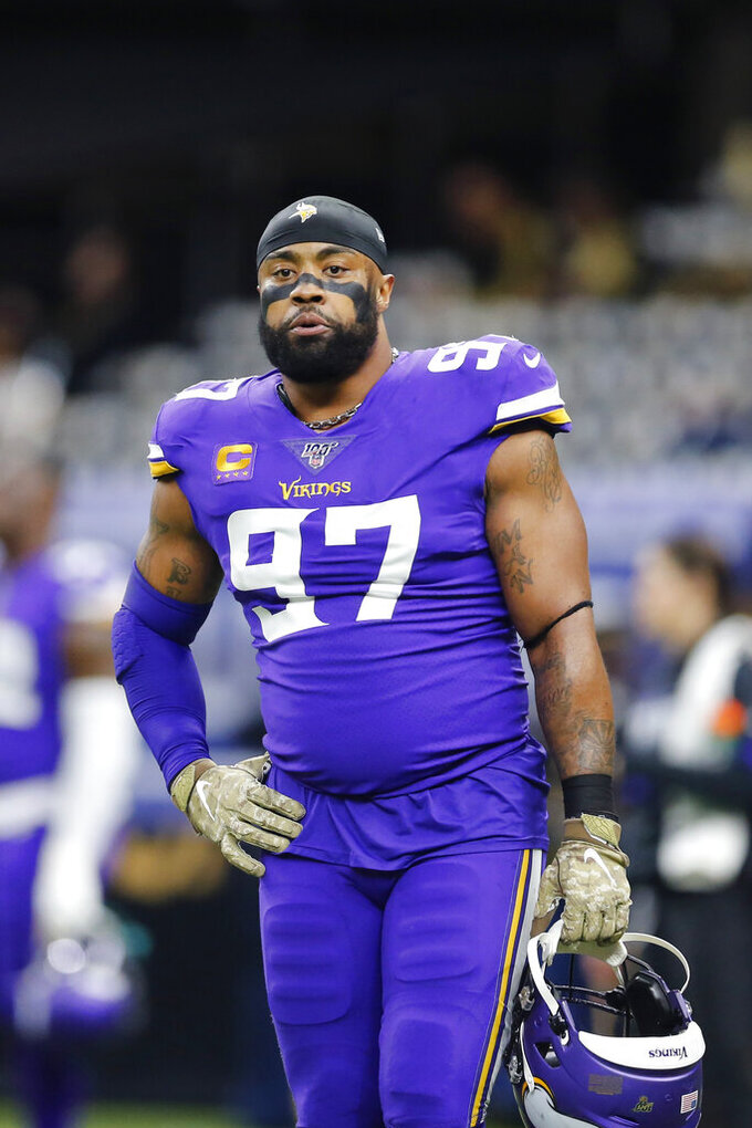 FILE - In this Jan. 5, 2020, file photo, Minnesota Vikings defensive end Everson Griffen (97) warms up before an NFL wild-card playoff football game against the New Orleans Saints in New Orleans. Vikings defensive end Everson Griffen will become a free agent for the first time in his 11-year career. He's coming off a bounce-back season for the longest-tenured player on the team. Griffen has chosen to exercise his option to void the remaining three years on his contract, a person with knowledge of the decision confirmed to The Associated Press. (AP Photo/Brett Duke, File)