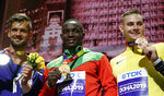 From left, silver medalist Magnus Kirt, of Estonia, gold medalist Anderson Peters, of Grenada, and bronze medalist Johannes Vetter, of Germany, display their medals at the World Athletics Championships in Doha, Qatar, Sunday, Oct. 6, 2019. (AP Photo/Morry Gash)