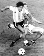 FILE - In this June 13, 1982 file photo, Argentina's Diego Maradona, front, is attacked by Belgium's Guy Vandermissen during the opening game of the Soccer World Cup in Barcelona, Spain. Maradona was the soul of Argentine soccer whose magic extended to Italy, where he bewitched Napoli fans. He died at 60, his health undercut by cocaine and obesity. (AP Photo, File)