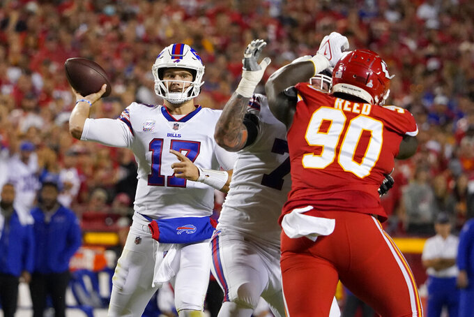 Buffalo Bills quarterback Josh Allen (17) throws over Kansas City Chiefs defensive tackle Jarran Reed (90) during the first half of an NFL football game Sunday, Oct. 10, 2021, in Kansas City, Mo. (AP Photo/Ed Zurga)