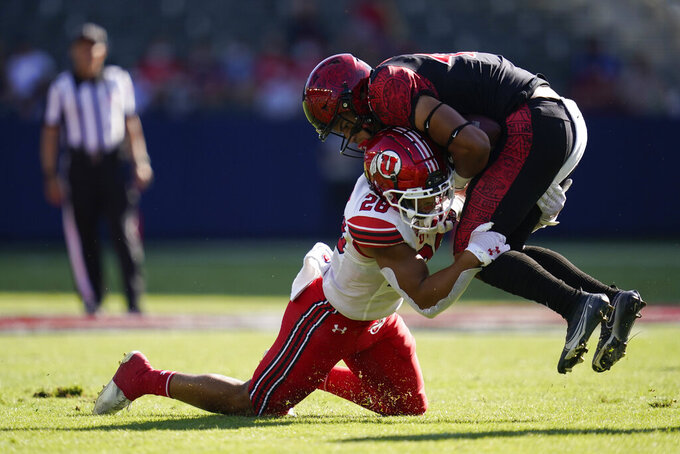 Utah safety Brandon McKinney (28) tackles San Diego State wide receiver Jesse Matthews (45) during the first half of an NCAA college football game Saturday, Sept. 18, 2021, in Carson, Calif. (AP Photo/Ashley Landis)