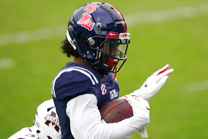 Mississippi wide receiver Dontario Drummond (11) runs into the end zone with a 48-yard touchdown pass reception during the first half of an NCAA college football game against Mississippi State, Saturday, Nov. 28, 2020, in Oxford, Miss. (AP Photo/Rogelio V. Solis)