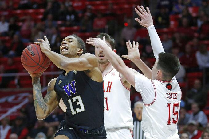 Utah guard Rylan Jones (15) guards Washington forward Hameir Wright (13) as he goes to the basket in the first half of an NCAA college basketball game Thursday, Jan. 23, 2020, in Salt Lake City. (AP Photo/Rick Bowmer)