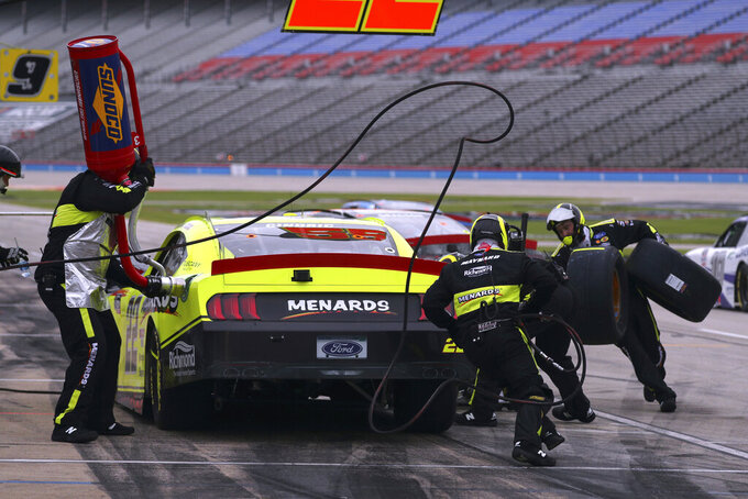 NASCAR Xfinity Series driver Austin Cindric (22) pits during a NASCAR Xfinity Series auto race at Texas Motor Speedway in Fort Worth, Texas, Saturday Oct. 24, 2020. (AP Photo/Richard W. Rodriguez)