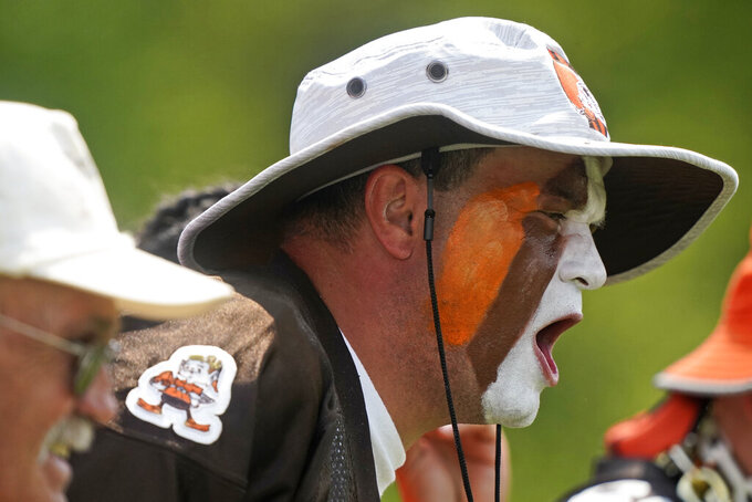 """Tim """"Pitdawg"""" Purchase cheers for the Cleveland Browns during an NFL football practice, Saturday, July 31, 2021, in Berea, Ohio. (AP Photo/Tony Dejak)"""
