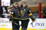 Vegas Golden Knights right wing Mark Stone, right, celebrates after defenseman Alec Martinez, left, scored a goal against St. Louis Blues during the second period of an NHL hockey game Friday, May 7, 2021, in Las Vegas. (AP Photo/John Locher)