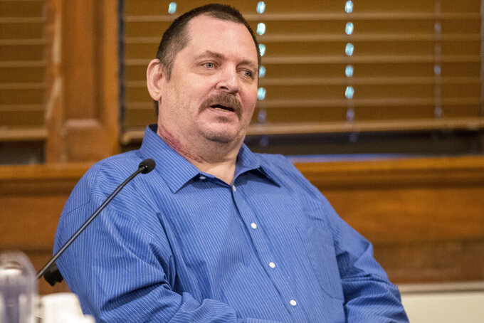 FILE - In this July 9, 2019, file photo, Aubrey Trail testifies during his murder trial at the Saline County Courthouse in Wilber, Neb. Trail was sentenced to death Wednesday, June 9, 2021, for killing and dismembering a Nebraska hardware store clerk who refused to commit to his lifestyle of group sex and fraud. (Chris Machian/Omaha World-Herald via AP, File)