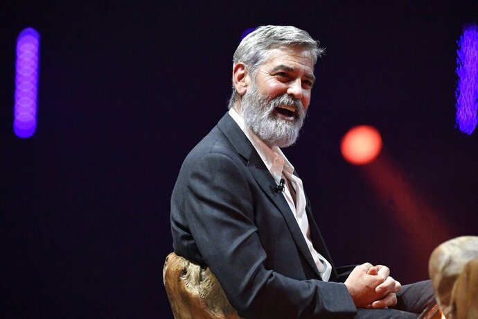 US actor and director George Clooney speaks to the crowd during the Nordic Business Forum business seminar in Helsinki, Thursday Oct. 10, 2019. (Heikki Saukkomaa/Lehtikuva via AP)