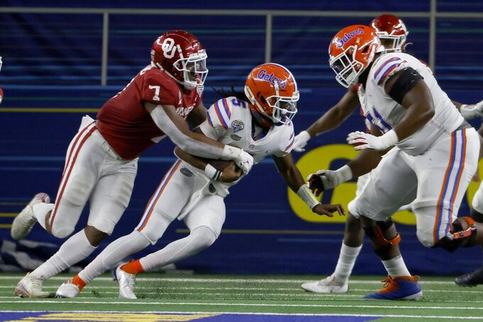 Oklahoma defensive end Ronnie Perkins (7) sacks Florida quarterback Emory Jones (5) durikng the second half of the Cotton Bowl NCAA college football game in Arlington, Texas, Wednesday, Dec. 30, 2020. (AP Photo/Ron Jenkins)