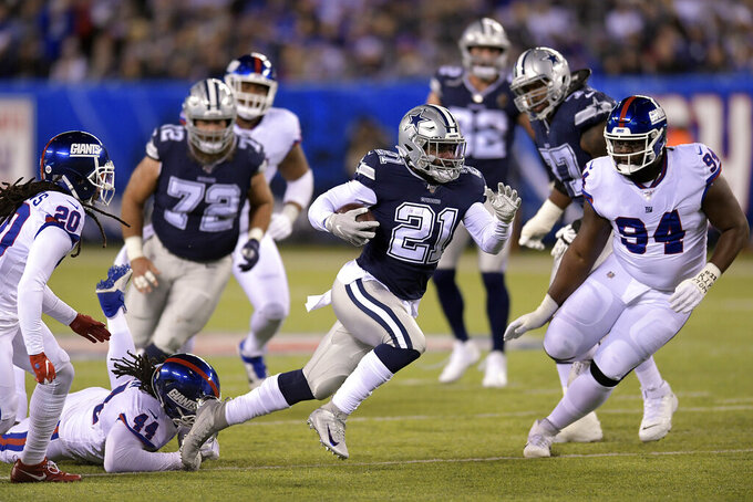 Dallas Cowboys running back Ezekiel Elliott (21) runs the ball against the New York Giants during the first quarter of an NFL football game, Monday, Nov. 4, 2019, in East Rutherford, N.J. (AP Photo/Bill Kostroun)