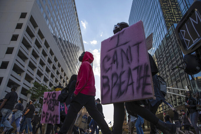 Protestors rally in downtown Indianapolis on Saturday, May 30, 2020. Protests were held in U.S. cities over the death of George Floyd, a black man who died after being restrained by Minneapolis police officers on May 25.  (Mykal McEldowney/The Indianapolis Star via AP)