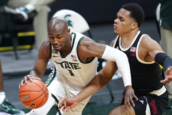 Michigan State guard Joshua Langford (1) drives on Nebraska guard Shamiel Stevenson (4) in the second half of an NCAA college basketball game in East Lansing, Mich., Saturday, Feb. 6, 2021. (AP Photo/Paul Sancya)