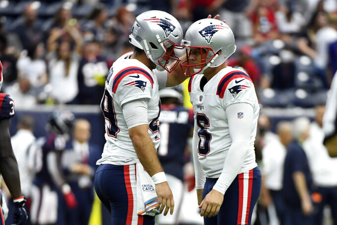 New England Patriots place kicker Nick Folk (6) celebrates with long snapper Joe Cardona after kicking a game-winning field goal against the Houston Texans during the second half of an NFL football game Sunday, Oct. 10, 2021, in Houston. The Patriots won 25-22. (AP Photo/Justin Rex)