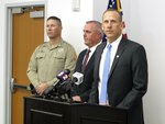 Washoe County District Attorney Chris Hicks, right, answers a reporter's question during a news conference in Reno, Nevada on Monday, Jan. 28, 2019, about murder charges filed against Wilber Martinez-Guzman in the killings of four people in northern Nevada earlier this month as Douglas County Sheriff Dan Coverley, left, and Douglas County District Attorney Mark Jackson, center, look on. (AP Photo/Scott Sonner)