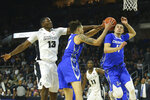 Providence's Kalif Young (13) battles for a rebound with Creighton's Christian Bishop (13) and Marcus Zegarowski (11) during the second half of an NCAA college basketball game Wednesday, Feb. 5, 2020, in Providence, R.I. (AP Photo/Stew Milne)