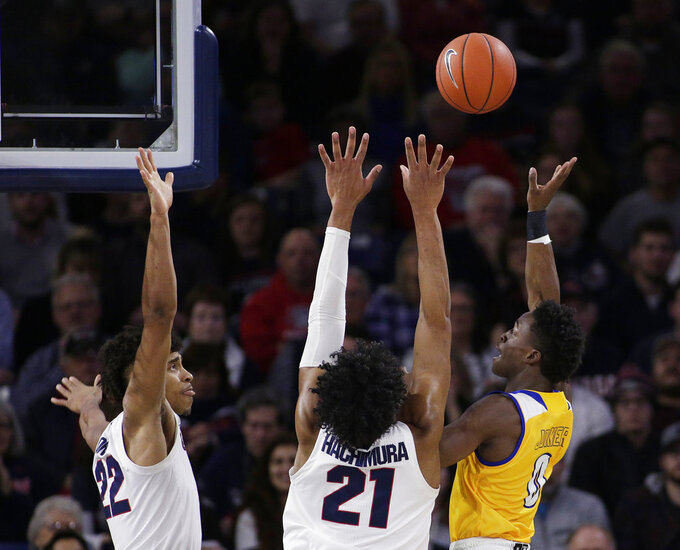 Cal State Bakersfield guard Jarkel Joiner (0) shoots while defended by Gonzaga forwards Rui Hachimura (21) and Jeremy Jones (22) during the first half of an NCAA college basketball game in Spokane, Wash., Monday, Dec. 31, 2018. (AP Photo/Young Kwak)