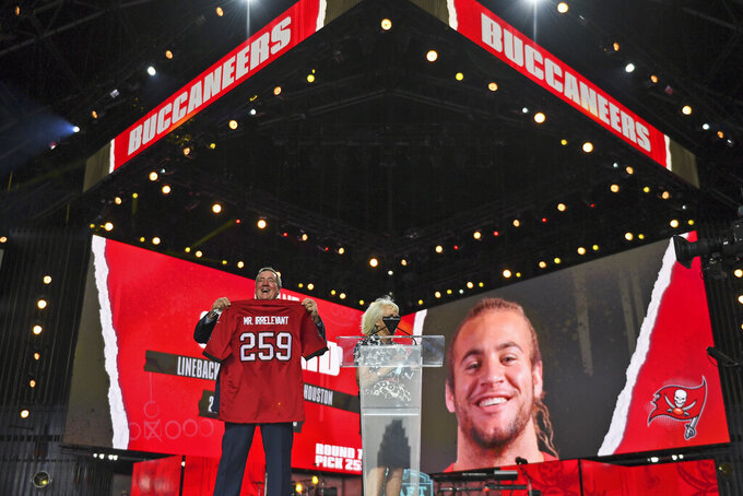 A Mr. Irrelevant jersey is held up for the Tampa Bay Buccaneers' pick during the seventh round of the NFL football draft, Saturday, May 1, 2021, in Cleveland. The final pick of the draft was Grant Stuard, a linebacker from Houston. (AP Photo/David Dermer)