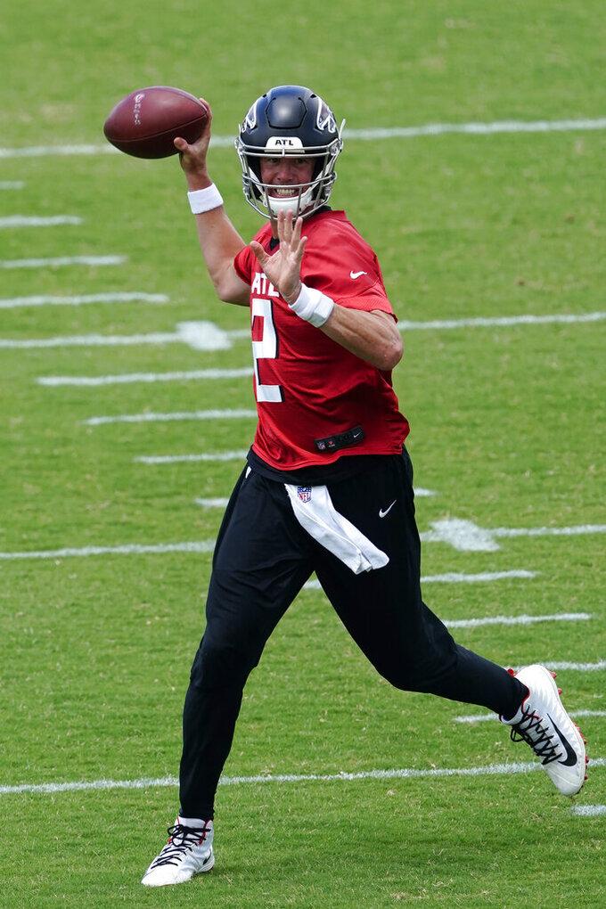 Atlanta Falcons quarterback Matt Ryan throws during a passing drill during the team's mini camp football practice Tuesday, June 8, 2021, in Flowery Branch, Ga. (AP Photo/John Bazemore)