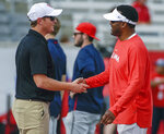 Houston head coach Major Applewhite, left, shakes hands with Arizona head coach Kevin Sumlin before an NCAA college football game, Saturday, Sept. 8, 2018, in Houston. (AP Photo/Eric Christian Smith)