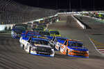 Sheldon Creed (2) races alongside Zane Smith (21) during a NASCAR truck series auto race at World Wide Technology Raceway Friday, Aug. 20, 2021, in Madison, Ill. (AP Photo/Jeff Roberson)