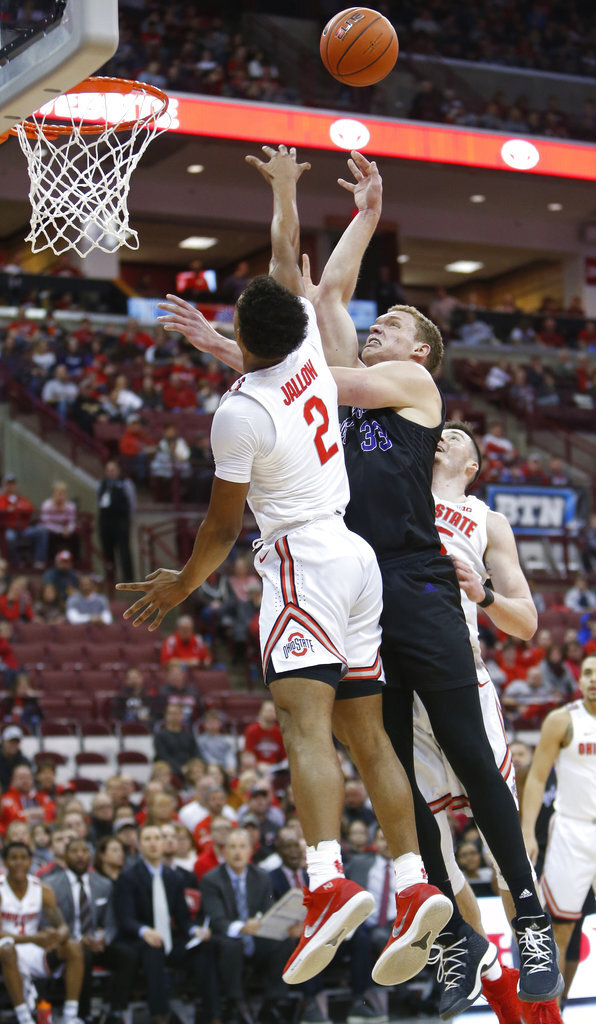 High Point's Sam Berlin, right, shoots over Ohio State's Musa Jallow during the first half of an NCAA college basketball game Saturday, Dec. 29, 2018, in Columbus, Ohio. (AP Photo/Jay LaPrete)