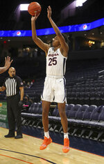 Virginia guard Trey Murphy III (25) shoots a three-point shot against St. Francis during an NCAA college basketball game, Tuesday, Dec. 1, 2020 in Charlottesville, Va. (Andrew Shurleff/The Daily Progress via AP)