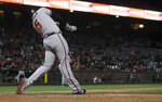 Atlanta Braves' Freddie Freeman hits an RBI single against the San Francisco Giants during the seventh inning of a baseball game in San Francisco, Tuesday, May 21, 2019. (AP Photo/Jeff Chiu)