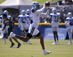 Dallas Cowboys wide receiver Ced Wilson catches a pass during the team's NFL football practice with the Los Angeles Rams on Saturday, Aug 7, 2021, in Oxnard, Calif. (AP Photo/John McCoy)