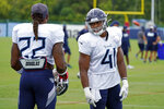 Tennessee Titans running back Khari Blasingame (41) talks with running back Derrick Henry (22) during NFL football training camp Friday, Aug. 28, 2020, in Nashville, Tenn. (AP Photo/Mark Humphrey, Pool)