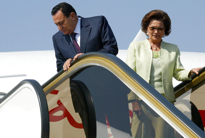 FILE -- In this May 11, 2006 file photo, then Egyptian President Hosni Mubarak and his wife Suzanne, arrive at Marrakesh airport in Morocco. One of the sons of Egypt's former autocratic President Hosni Mubarak says his 78-year-old mother and former first lady is in hospital. Alaa Mubarak tweeted late Wednesday, Nov. 20, 2019, that Suzanne Mubarak was in intensive care but didn't elaborate on her illness. (AP Photo/Jalil Bounhar, File)