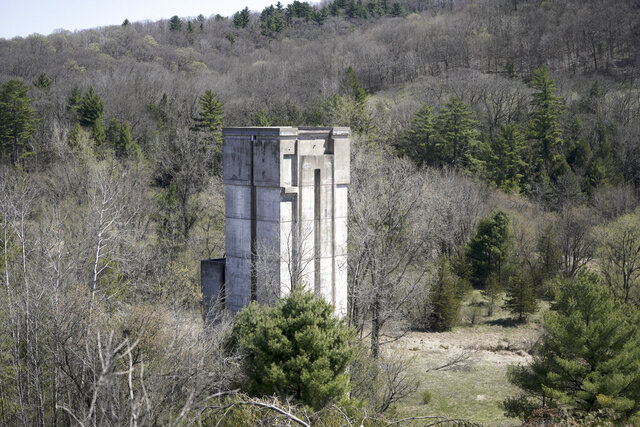 A concrete tower that would have been used to funnel high water from a proposed lake is one of the reminders of a failed plan to flood the Kickapoo River Valley north of La Farge. Millions of dollars were spent on the project, including the partial construction of an earthen dam to hold back the flood-prone Kickapoo River. The valley is now home to the Kickapoo Valley Reserve. The Reserve was photographed Thursday, April 30, 2020. (Steve Apps/Wisconsin State Journal via AP)