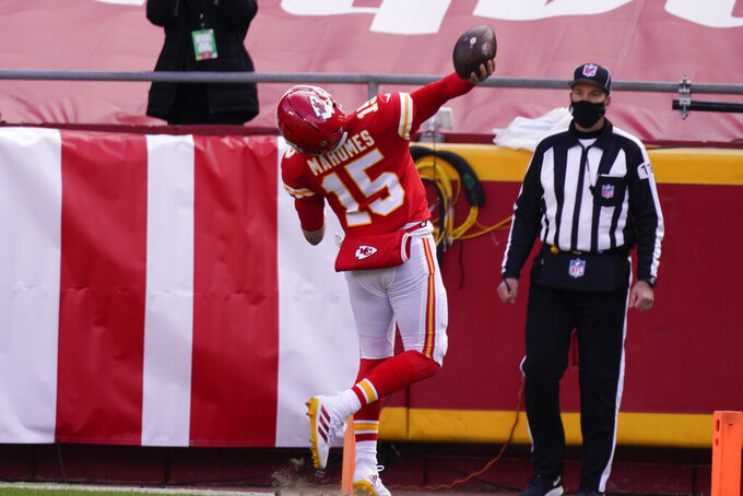 Kansas City Chiefs quarterback Patrick Mahomes celebrates after scoring on a touchdown run during the first half of an NFL divisional round football game against the Cleveland Browns, Sunday, Jan. 17, 2021, in Kansas City. (AP Photo/Charlie Riedel)