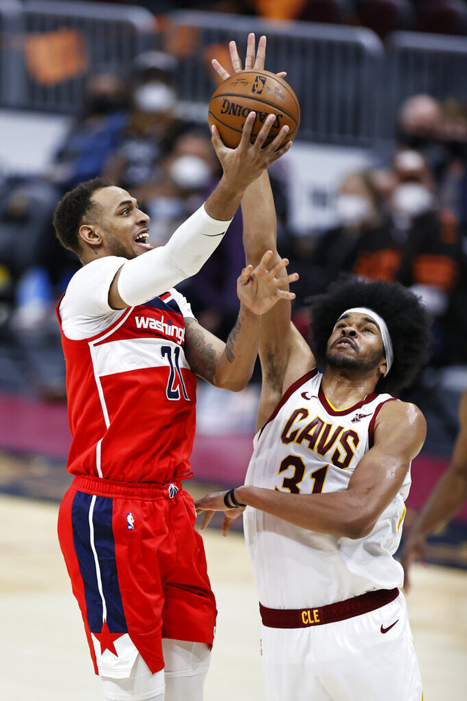 Washington Wizards' Daniel Gafford (21) shoots over Cleveland Cavaliers' Jarrett Allen (31) during the second half of an NBA basketball game, Friday, April 30, 2021, in Cleveland. (AP Photo/Ron Schwane)