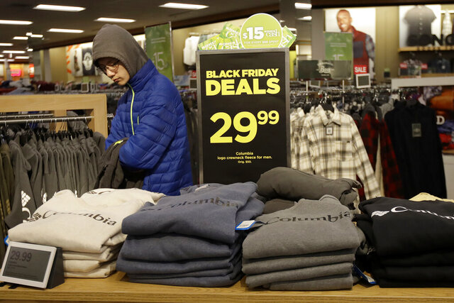 FILE- In this Nov. 29, 2019, file photo customers shop at a Kohl's store in Colma, Calif. On Friday, Dec. 13, the Commerce Department releases U.S. retail sales data for November. (AP Photo/Jeff Chiu, File)