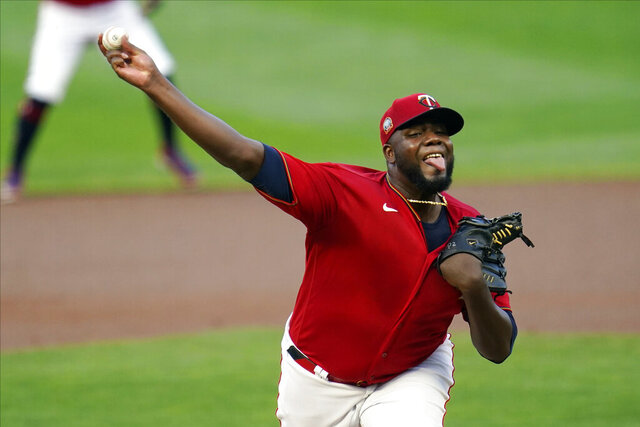 Minnesota Twins pitcher Michael Pineda throws to a Chicago White Sox batter during the first inning of a baseball game Tuesday, Sept. 1 2020, in Minneapolis. Pineda returned after serving a 60-game suspension for testing positive for a weight-loss drug on baseball's banned substances list. (AP Photo/Jim Mone)