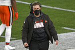 Cleveland Browns coach Callie Brownson walks on the sideline during the first half of an NFL wild-card playoff football game against the Pittsburgh Steelers in Pittsburgh, Sunday, Jan. 10, 2021. (AP Photo/Don Wright)