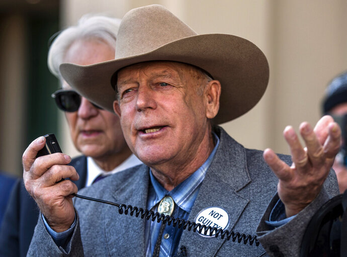 FILE - In this Jan. 10, 2018 file photo, Cliven Bundy talks to reporters outside Las Vegas Metropolitan Police Headquarters in Las Vegas. The 9th U.S. Circuit Court of Appeal in San Francisco on Thursday, Aug. 6, 2020, denied prosecutors' efforts to overturn U.S. District Judge Gloria Navarro's decision to stop a months-long trial in January 2018 due to prosecutorial misconduct and her order dismissing the case so it could not be re-filed. (L.E. Baskow/Las Vegas Sun via AP, File)