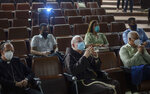 The Archbishop of Boston, Cardinal Sean Patrick O'Malley, center, listens to a presentation at Cuba's Genetic Engineering and Biotechnology Center where the island's locally developed COVID-19 vaccines are made in Havana, Cuba, Thursday, Sept. 9, 2021. (AP Photo/Ramon Espinosa)