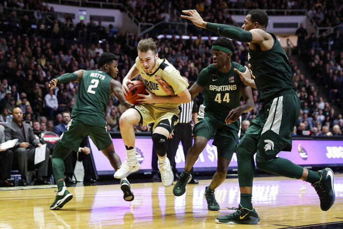 Purdue guard Sasha Stefanovic (55) hops between Michigan State guard Rocket Watts (2) and forward Gabe Brown (44) during the second half of an NCAA college basketball game in West Lafayette, Ind., Sunday, Jan. 12, 2020. (AP Photo/Michael Conroy)