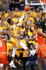 Pittsburgh's Xavier Johnson, left, goes up to score as Syracuse's Paschal Chukwu, right, defends during the first half of an NCAA college basketball game, Saturday, Feb. 2, 2019, in Pittsburgh. (AP Photo/Keith Srakocic)