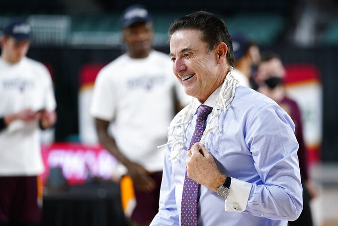 Iona head coach Rick Pitino celebrates after Iona won an NCAA college basketball game against Fairfield during the finals of the Metro Atlantic Athletic Conference tournament, Saturday, March 13, 2021, in Atlantic City, N.J. (AP Photo/Matt Slocum)