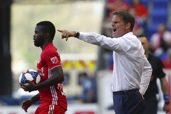 FILE - In this May 19, 2019, file photo, Atlanta United head coach Frank de Boer, right, yells instructions to his team during the first half of an MLS soccer match against the New York Red Bulls, in Harrison, N.J. Atlanta United, the defending MLS Cup champions, are heading into the playoffs from essentially the same position as last season. (AP Photo/Steve Luciano, File)