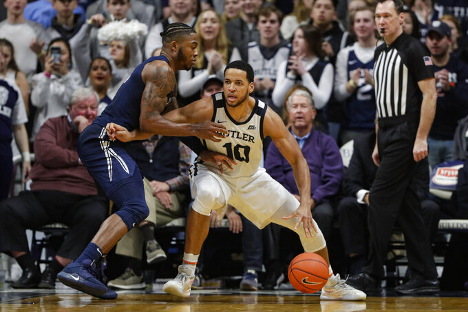 Butler forward Bryce Nze (10) drives on Xavier forward Tyrique Jones (4) in the second half of an NCAA college basketball game in Indianapolis, Wednesday, Feb. 12, 2020. Butler defeated Xavier 66-61. (AP Photo/Michael Conroy)