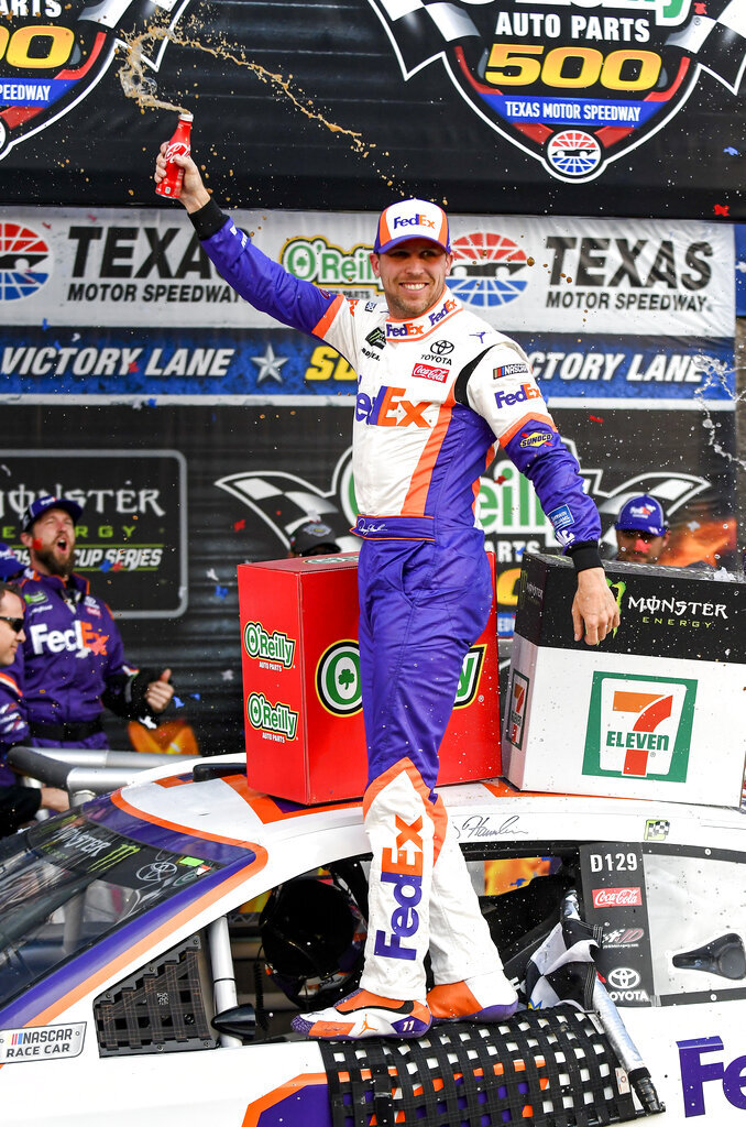 Driver Denny Hamlin celebrates in victory lane after winning a NASCAR Cup auto race at Texas Motor Speedway, Sunday, March 31, 2019, in Fort Worth, Texas. (AP Photo/Randy Holt)