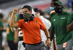 Miami head coach Manny Diaz celebrates a touchdown against Florida State during the first half of an NCAA college football game, Saturday, Sept. 26, 2020, in Miami Gardens, Fla. (Michael Laughlin/South Florida Sun-Sentinel via AP)