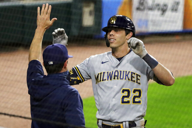 FILE - In this Thursday, Aug. 6, 2020, file photo, Milwaukee Brewers' Christian Yelich, right, celebrates with manager Craig Counsell after hitting an inside-the-park home run against the Chicago White Sox during the fifth inning of a baseball game in Chicago. Counsell is confident former MVP Yelich's 2020 hitting struggles won't carry over into next season. (AP Photo/Nam Y. Huh, File)