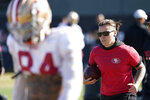San Francisco 49ers offensive assistant Katie Sowers, right, leads a drill during practice at the team's NFL football training facility in Santa Clara, Calif., Friday, Jan. 24, 2020. The 49ers will face the Kansas City Chiefs in Super Bowl 54. (AP Photo/Tony Avelar)